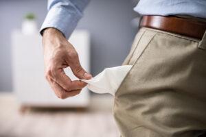 bankrupt-man-showing-empty-pocket