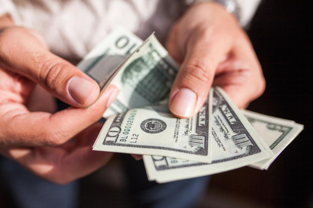 holding-dollar-bills